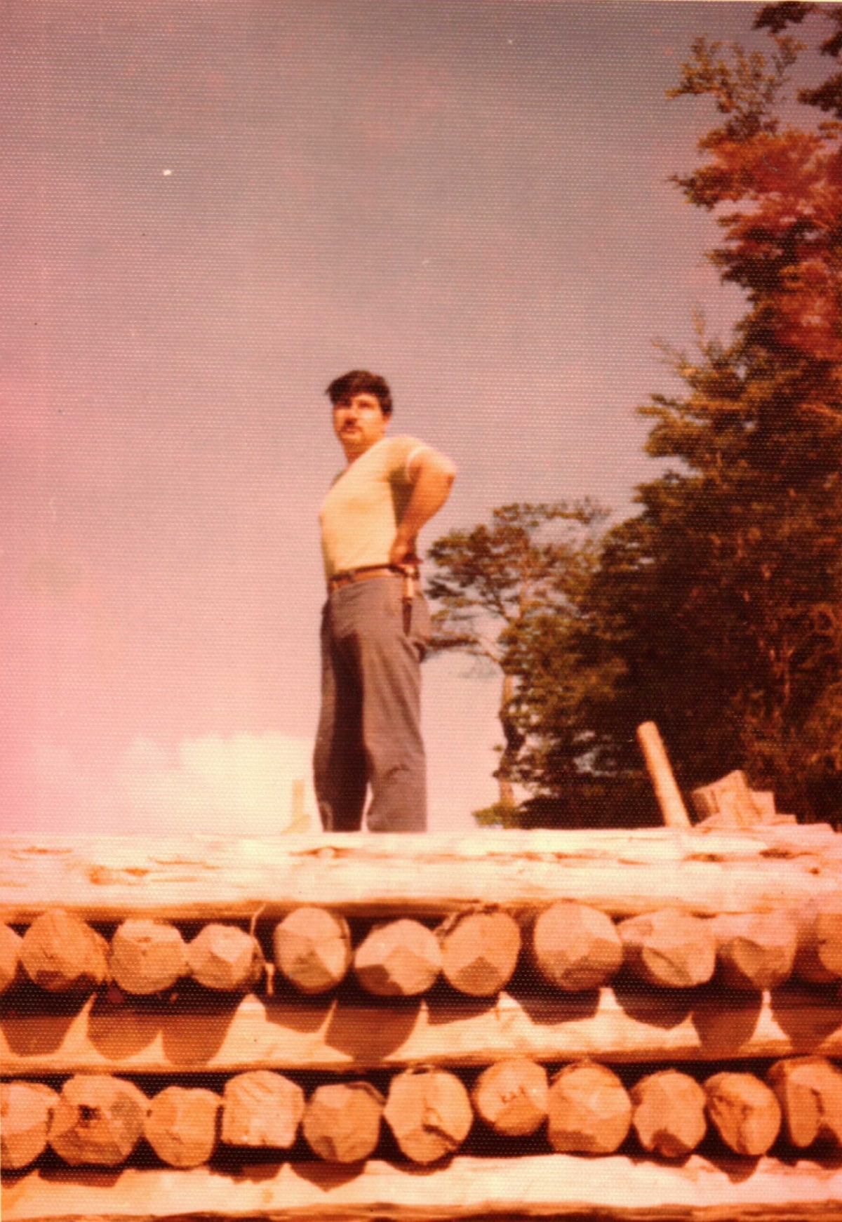 Sergeant Raimundo García helps collecting wooden poles in Tortel,1976.  Photo: Carmen Rojas Chavez.