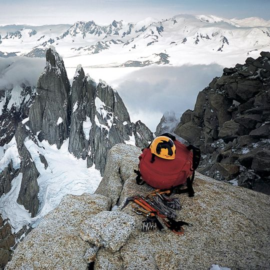 Flying raven, burning sun. Potter's partners on the summit of Fitz Roy after climbing Supercanaleta. Photo: Dean S. Potter