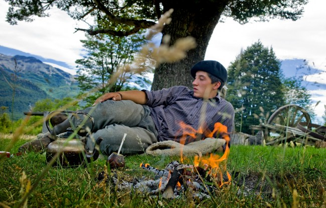 A young gaucho rests after a day of measuring saplings with researchers. His father and grandfather burned the trees in the region to make way for grazing, but his generation of Patagonian's is now a part of protecting the forests and helping them to regenerate to encourage other forms of economy like tourism.