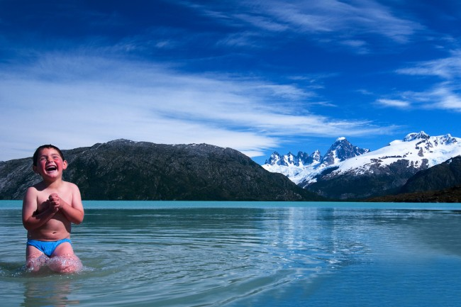 Juan Jose Soto (age 4) playing in the icy glacial waters of Lake O'Higgins. The place Juan is playing would be have been flooded if the dams had been built.